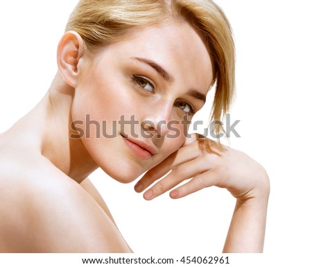 Charming Woman with perfect skin. Close up of an attractive girl of European appearance on white background. Beauty & Spa Concept. - stock photo