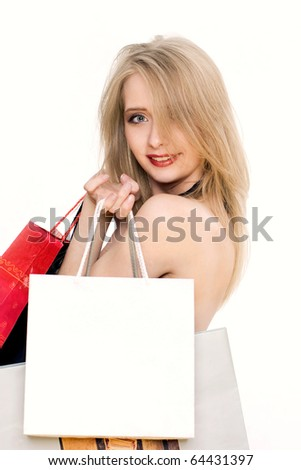 Charming young blonde woman going shopping. A bag with empty space to fill in.