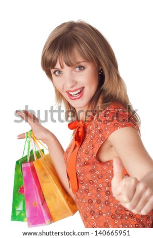 charming young brunette holding colorful shopping bags