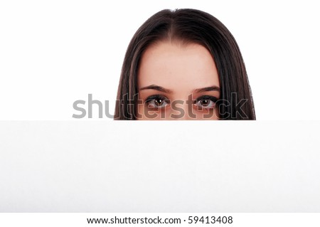 charming young brunette, isolated on white holding a white square - stock photo