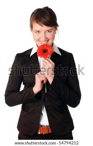 charming young business woman in a business suit with a red flower in the hands - stock photo