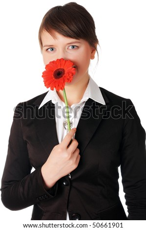 charming young business woman playing with a red flower - stock photo