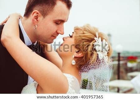 charming young couple embracing outdoors - stock photo