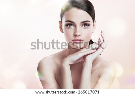 Charming young female with perfect makeup, skin care concept / photoset of attractive brunette girl on blurred beige background with bokeh   - stock photo