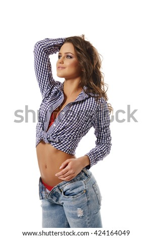 Charming young girl dressed in sexy casual clothes - stock photo