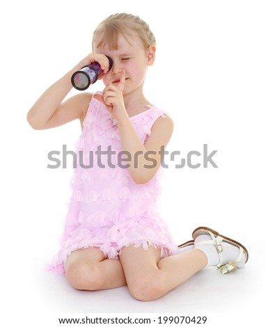 Charming young girl with kaleidoscope - stock photo