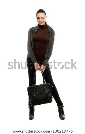 Charming young lady posing with a bag. Isolated on white