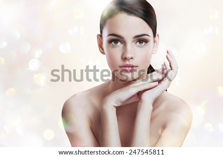 Charming young lady with perfect makeup, skin care concept / photoset of attractive brunette girl on blurred background with bokeh  - stock photo