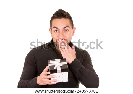 charming young man holding a gift box looking happily surprised isolated on white - stock photo