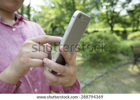 Charming young woman close-up reads message to mobile phone, - stock photo