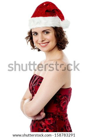Charming young woman dressed in santa cap