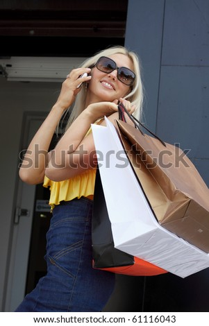 charming young woman going shopping - stock photo