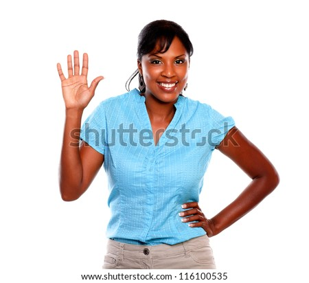 Charming young woman greeting on blue shirt against white background - stock photo