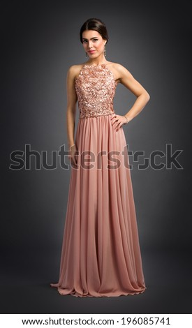 Charming young woman posing in luxury dress - stock photo