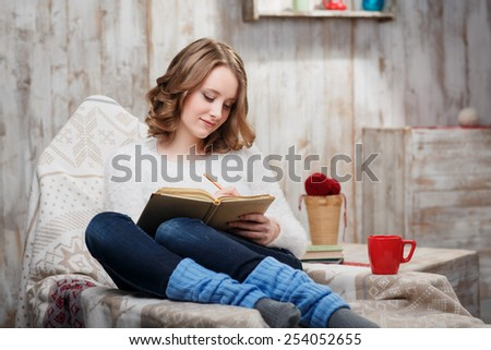 Charming young woman relaxing in country house - stock photo