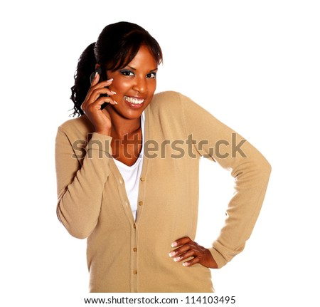 Charming young woman speaking on cellphone on isolated background
