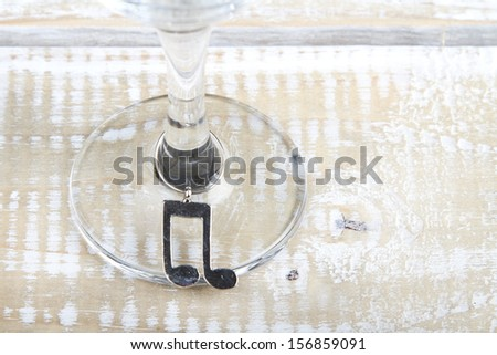 Charms on a wine glass - stock photo