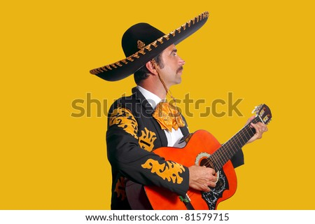 Charro Mariachi man playing guitar on yellow background