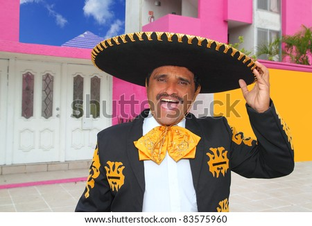 Charro mariachi man portrait shouting in mexican pink house - stock photo