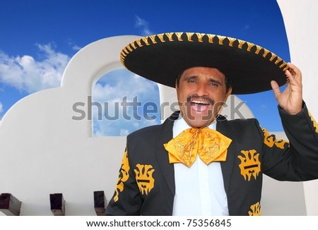 Charro mariachi portrait singing shout in mexican houses background [Photo Illustration] - stock photo