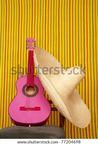 charro mexican hat pink guitar in striped background - stock photo