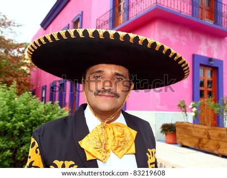 Charro mexican Mariachi man portrait in a pink Mexico house - stock photo