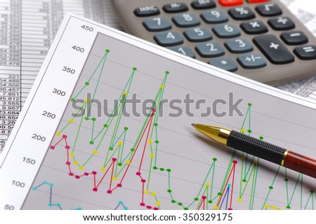 chart and calculator show success at stock market - stock photo