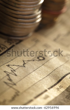 chart and coin - stock photo