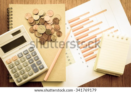 chart and money  on the wooden table with vintage color style  - stock photo