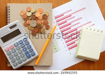 chart and money on wooden background with business concept