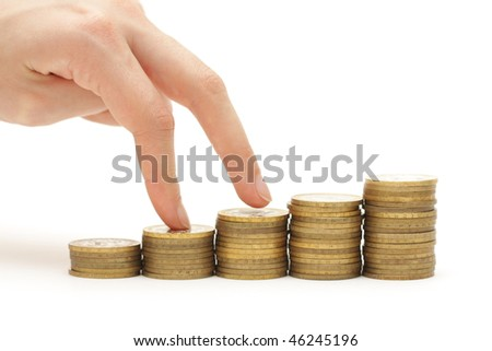 Chart made of coins isolated on white background - stock photo
