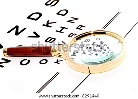 chart through a magnifier. Isolation. - stock photo