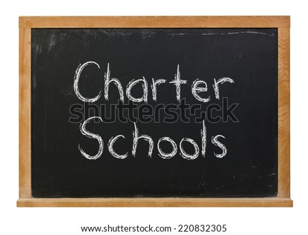 Charter Schools written in white chalk on a black chalkboard isolated on white - stock photo
