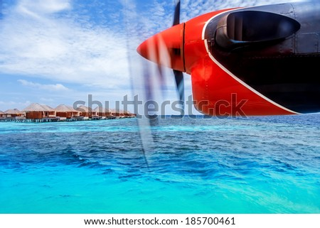 Charter to exotic resort, little airplane flying to exotic country, luxury travel, summer vacation and holidays concept - stock photo