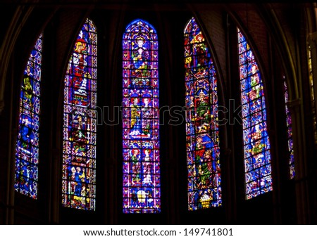 CHARTRES, FRANCE - APRIL 23:old stained-glass windows in Cathedral of Our Lady of Chartres  on april 23, 2013 in Chartres. Cathedrale Notre-Dame de Chartres is on UNESCO list. - stock photo