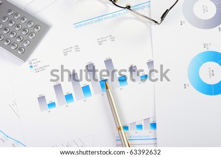 Charts and graphs of sales - a symbol of successful corporate business - stock photo