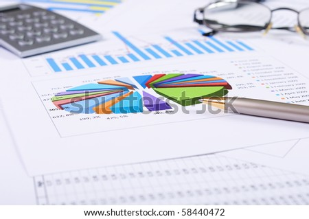 charts and graphs of sales of securities - workplace successful business man - stock photo