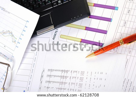 Charts, diagrams, tables. Workplace for the business person. - stock photo