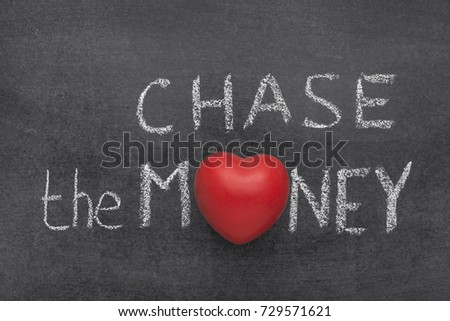 chase the money phrase handwritten on blackboard with heart symbol instead of O