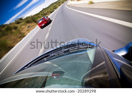 Chasing red car along the highway - stock photo