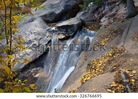 Chasm Falls along the Fall River Road in the Rocky Mountain National Park, Colorado. - stock photo