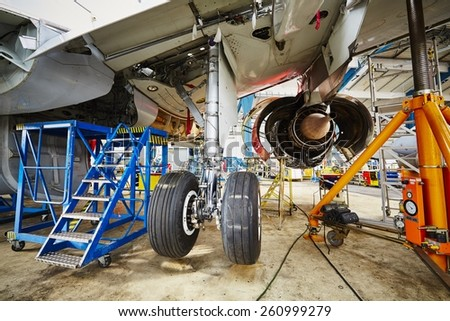 Chassis of the airplane under heavy maintenance - stock photo