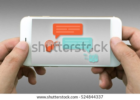 Chat bot and future marketing concept. Businessman hands holding white phone with Chatbot infographic with gray aluminium background.