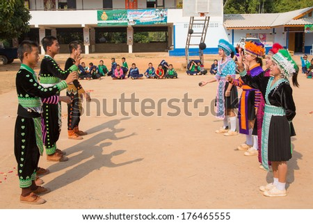 CHAT TRAKAN PHITSANULOK /THAILAND - Feb 12 : Unidentified traditionally dressed Hmong hill tribe girl play a ball in Hmong new year festival on Feb 12, 2014 in Pisanulok, Thailand. - stock photo