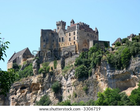 Chateau and chapel on a rocky cliff in the Dordogne region of France