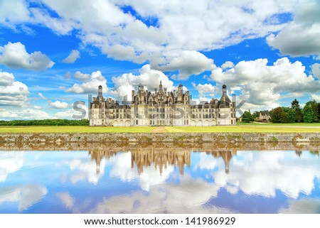Chateau de Chambord, royal medieval french castle and reflection. Loire Valley, France, Europe. Unesco heritage site. - stock photo