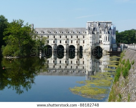 Chateau de Chenonceau spanning the Cher river near Chenonceaux in France - stock photo