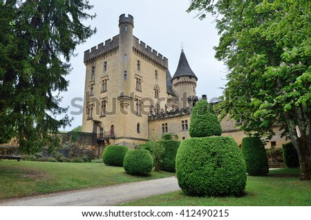 Chateau de Puymartin is a fine example of Renaissance architecture and Gothic Revival. This is a medieval French castle in the Dordogne department. - stock photo