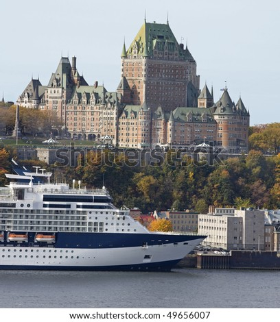 Chateau Frontenac and Cruise Ship in autumn - stock photo