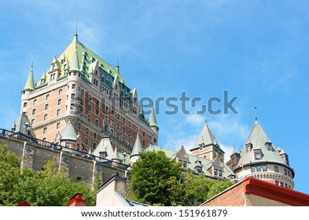 Chateau Frontenac Hotel in Quebec City against a blue summer sky. The first version of this castle like hotel was designed by architect Bruce Price and opened to public in 1893. - stock photo